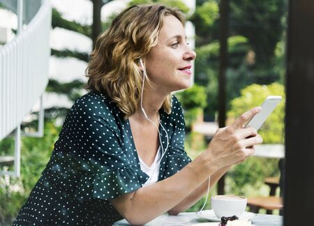 Caucasian woman with a smartphone Stock Photo