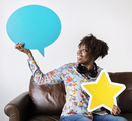 Happy African American holding copy space speech bubble and a star sign Stockfoto