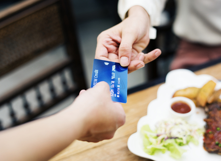 Woman paying lunch with credit card at restaurant Stock Photo