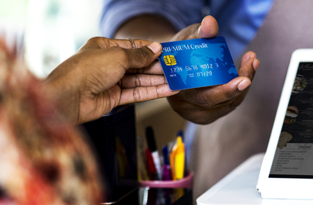 Customer paying for bakery products by credit card Stock Photo