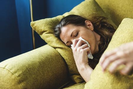 Woman sick on the sofa Stock Photo - 98014865