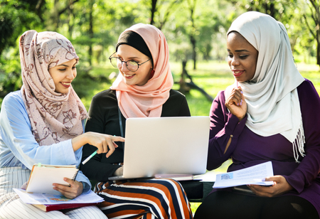 Muslim women having discussion outdoors