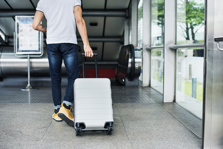 White man carrying luggage Stock Photo - 98041903