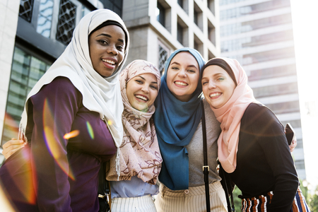 Happy muslim women in modern city
