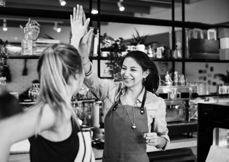 Women give a high five to each other Reklamní fotografie - 98708422