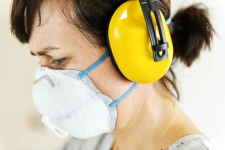 Woman wearing ear protection Banque d'images - 98750827