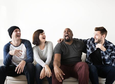 Group of diverse friends hanging out together Stock Photo