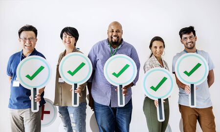 Workers standing and holding correct ticks logos Stock Photo