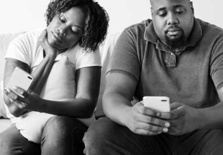 Black couple using digital device Stock Photo