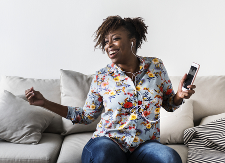 African American woman enjoying music at home leisure and music concept Stock Photo