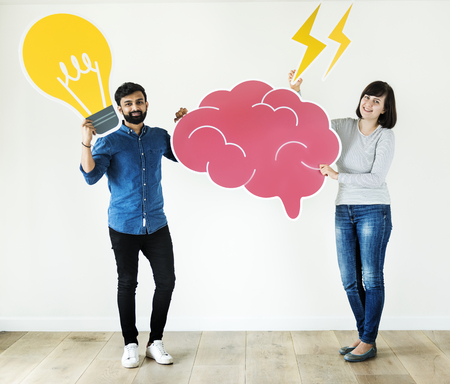 Couple holding brain and light bulb icon innovation and idea concept