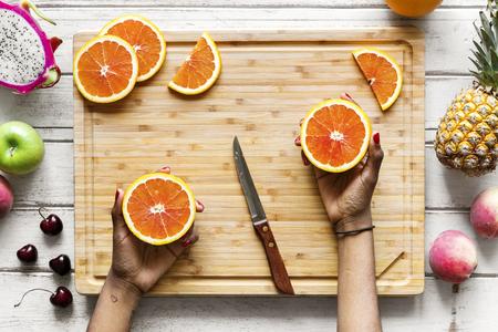 Cutting up healthy fresh oranges Stock Photo