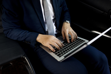 Businessman sitting in the car Stock Photo