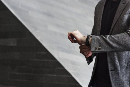 Man looking at his watch Stock Photo