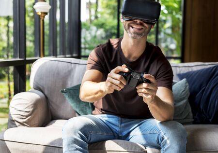 People enjoying virtual reality goggles Stock Photo