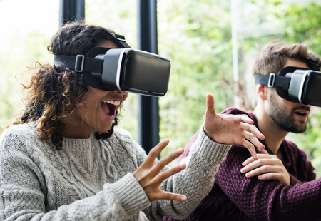 Young couple using VR together