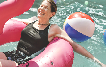 Woman enjoying the water in a swimming pool Stock Photo