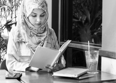 Muslim woman reading a book