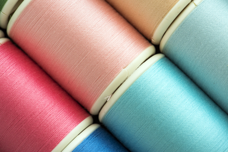 Colorful sewing threads background closeup 版權商用圖片