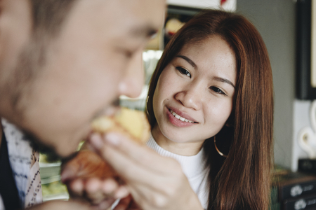 Asian girl feeding her boyfriend