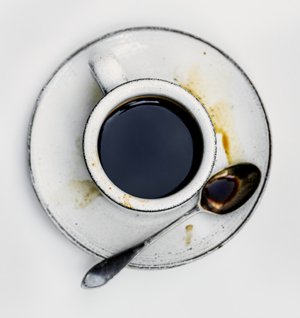 Aerial view of hot coffee in white cup