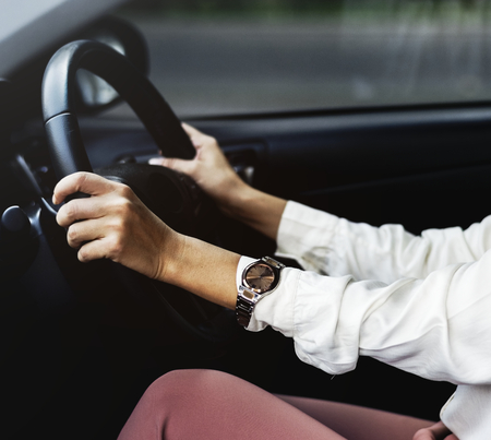 Woman driving a car on a road Stockfoto