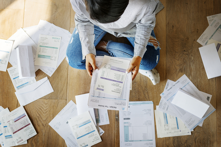 Woman managing the debt Stock Photo