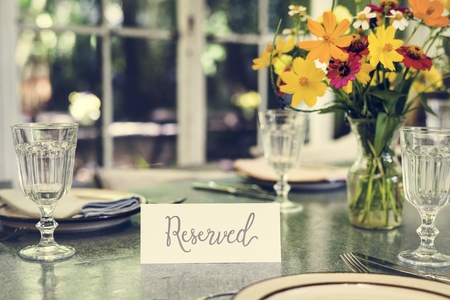 Restaurant table setting service with reserved card Stok Fotoğraf