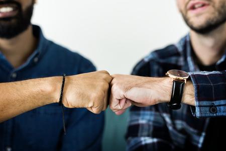 Closeup of men fist bumping