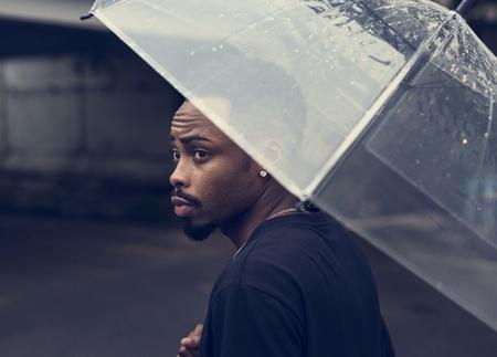 African descent man in an umbrella