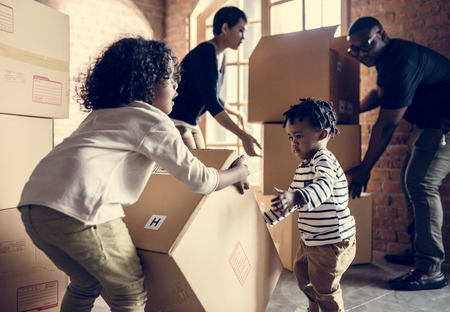 African family unpacking stuffs