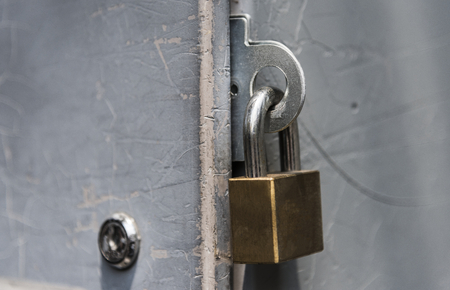 Closeup of a locked padlock Stock fotó