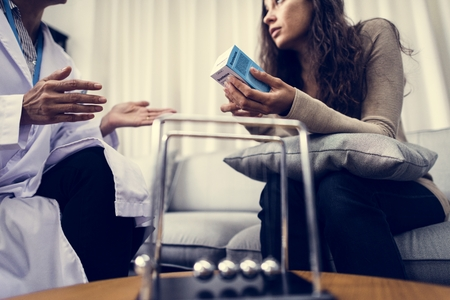 Depressed woman having a counseling session Stock Photo
