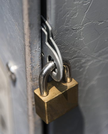 Closeup of a locked padlock Stock Photo