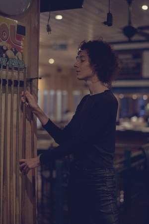 Woman picking up a cue stick Stock Photo