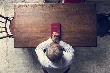 Senior man prayer faith in christianity religion