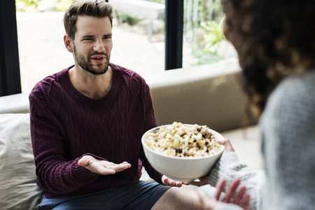 A man asking for a popcorn