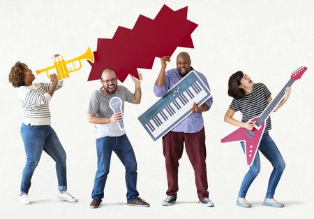 Group of diverse people enjoying music instruments