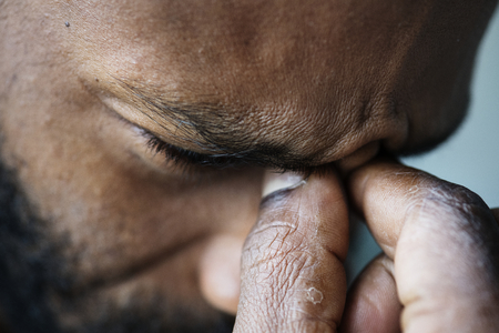Portrait of stressed black man Imagens