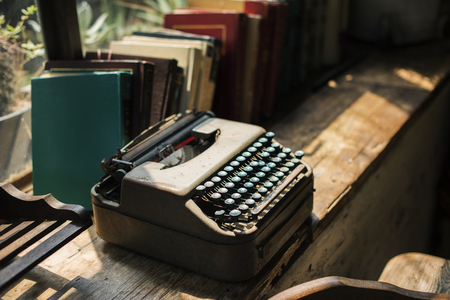 Retro typewriter and books