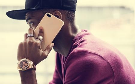 African man using mobile phone Reklamní fotografie - 100175724
