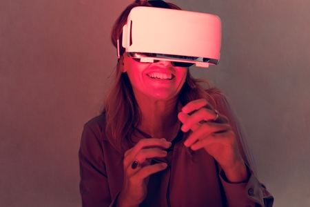 Woman using virtual reality gadget for entertainment