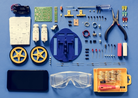 Aerial view of electronics tools equipments on blue background Stock Photo