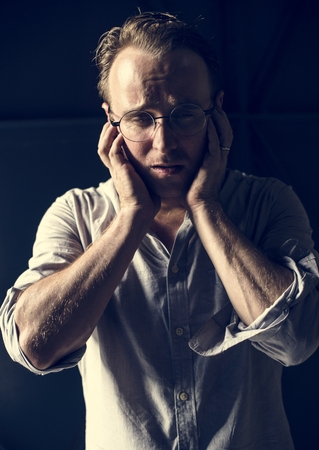 Caucasian man panic stressed face expression Stockfoto - 100176637