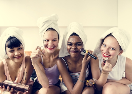 A diverse group of women using makeup