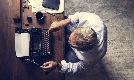 Hands with retro vintage typewriter