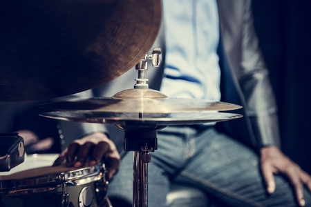 Drummer performing in an event 写真素材