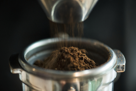 Closeup of fresh grinding coffee Stock Photo