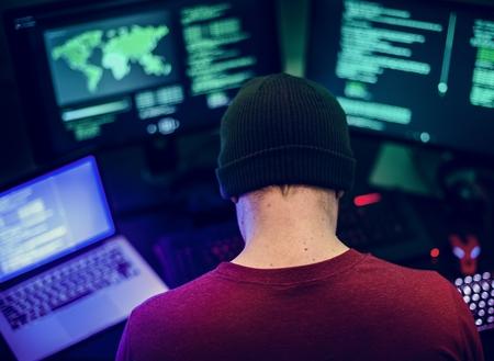 Caucasian man working on coding  Imagens