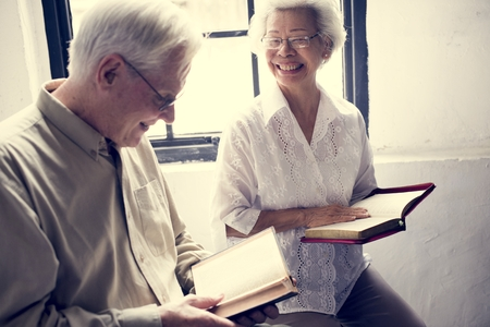 Senior people reading bible in christianity religion